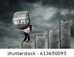 young businesswoman climbing a... | Shutterstock . vector #613650095