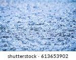 heavy rain drops with selective ... | Shutterstock . vector #613653902