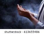 muslim man praying | Shutterstock . vector #613655486