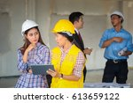asian construction engineer and ... | Shutterstock . vector #613659122