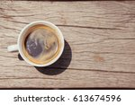 coffee cup on wooden table  ... | Shutterstock . vector #613674596