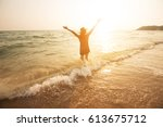 happy woman at the sea at... | Shutterstock . vector #613675712