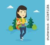 asian backpacker with backpack... | Shutterstock .eps vector #613691186