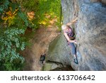 older woman rock climber is... | Shutterstock . vector #613706642