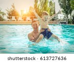 father and son funny in  water... | Shutterstock . vector #613727636