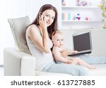 young mother holding a year old ... | Shutterstock . vector #613727885