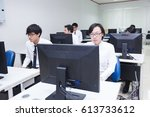 Small photo of Bangkok, Thailand - November 17, 2015 : King Mongkut's Institute of Technology is a research and educational institution. A class of students in front of their screens study computer science.