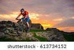 cyclist riding the mountain... | Shutterstock . vector #613734152