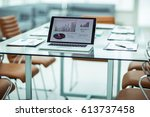 workplace with open laptop and... | Shutterstock . vector #613737458