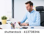 happy businessman working on... | Shutterstock . vector #613738346