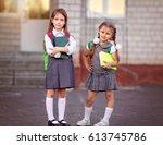 happy schoolgirls are going to... | Shutterstock . vector #613745786