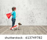 little boy with dog indoors | Shutterstock . vector #613749782