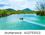 the long tail boat and fishing... | Shutterstock . vector #613752512