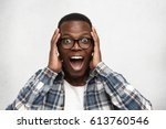 portrait of excited young... | Shutterstock . vector #613760546
