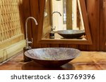 Small photo of Vintage brass wash basin and faucet in wooden bathroom.