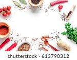 spices in wooden spoon on white