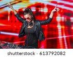 young dj in nightclub | Shutterstock . vector #613792082