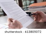checking a document in office | Shutterstock . vector #613805072