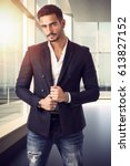 handsome young male worker in... | Shutterstock . vector #613827152