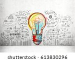 large and colorful light bulb... | Shutterstock . vector #613830296