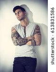 handsome tattooed young man... | Shutterstock . vector #613831586