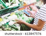 Young Woman Shopping Healthy...