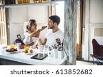 young happy couple sitting by...   Shutterstock . vector #613852682