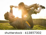happy father playing and lying... | Shutterstock . vector #613857302
