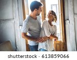 young happy couple embracing... | Shutterstock . vector #613859066