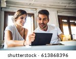 happy young couple watching... | Shutterstock . vector #613868396
