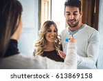 young happy couple smiling and... | Shutterstock . vector #613869158