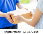 Asian Woman Receiving A Packag...