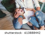 mom and daughter are hugging in ... | Shutterstock . vector #613888442