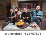 a company of men having fun and ... | Shutterstock . vector #613907876