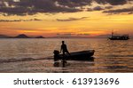 Silhouette Of One Fisherman On...
