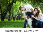 Stock photo a young couple walking a dog in the park 61391779