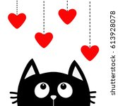 black cat looking up to hanging ... | Shutterstock . vector #613928078