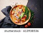 fried vegetables  potatoes ...   Shutterstock . vector #613938536