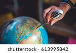 globe model and hand holding... | Shutterstock . vector #613995842