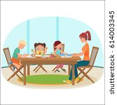 a woman sitting at the table in ... | Shutterstock .eps vector #614003345