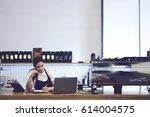 attractive experienced barista... | Shutterstock . vector #614004575