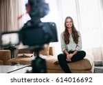 young woman recording video on... | Shutterstock . vector #614016692