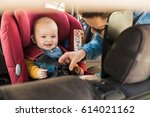 father fasten his little baby... | Shutterstock . vector #614021162