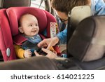 father fasten his little baby... | Shutterstock . vector #614021225