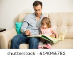 handsome latin father sitting... | Shutterstock . vector #614046782