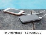 powerbank battery charging... | Shutterstock . vector #614055332
