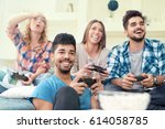 smiling friends playing video... | Shutterstock . vector #614058785