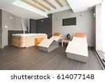 sunbeds in hotel spa center | Shutterstock . vector #614077148