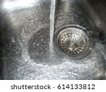 flowing water in a kitchen sink | Shutterstock . vector #614133812