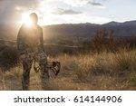 Archery Hunter Walking With Hi...